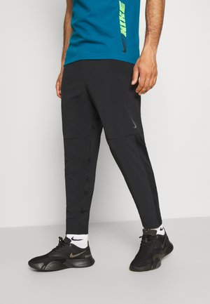 PANT YOGA - Tracksuit bottoms - black/iron grey