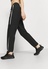 Nike Performance - PANT - Tracksuit bottoms - black/metallic silver - 3