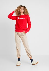Champion Reverse Weave - BIG SCRIPT CREWNECK - Sweatshirt - red - 1