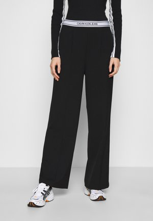 LOGO ELASTIC DRAPEY PANT - Kalhoty - black