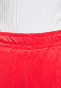 Nike Sportswear - Tracksuit bottoms - track red - 5