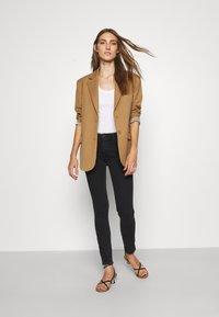 Emporio Armani - Jeans Skinny Fit - black denim - 1