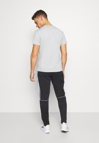 adidas Performance - SERENO AEROREADY TRAINING SPORTS SLIM PANTS - Träningsbyxor - black/white - 2