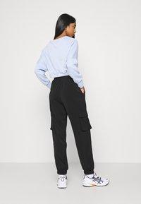Vero Moda - VMCOCO PANT - Cargo trousers - black - 2