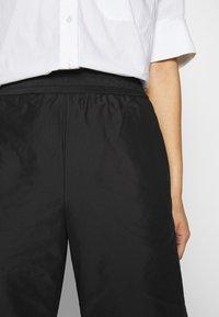 Hope - ACE TROUSER - Trousers - black taffeta - 5