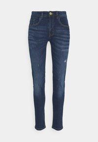 STOCKHOLM DESTROY - Slim fit jeans - caribbean sea