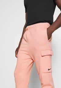 Nike Sportswear - PANT CARGO - Tracksuit bottoms - pink quartz - 4