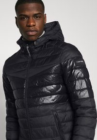 Calvin Klein - HOODED JACKET - Light jacket - black - 3