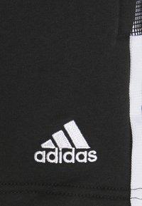 adidas Performance - TIRO - Sports shorts - black - 2