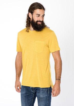 SUPER.NATURAL MERINO T-SHIRT M CITY TEE - Basic T-shirt - gelb
