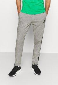 adidas Performance - Tracksuit bottoms - medium grey heather/black - 0