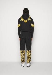 Versace Jeans Couture - CRINKLE  - Tracksuit bottoms - black - 2