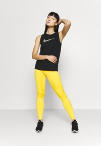 Nike Performance - DRY TANK LEOPARD - Funktionsshirt - black - 1