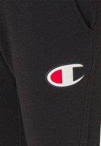 Champion Rochester - CUFF PANTS - Tracksuit bottoms - black - 6