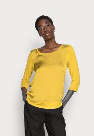 THILDE - Blusa - honey yellow