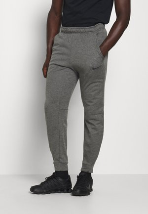 THRMA TAPER - Tracksuit bottoms - charcoal heather/black