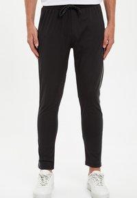 DeFacto Fit - Pantaloni sportivi - black - 1