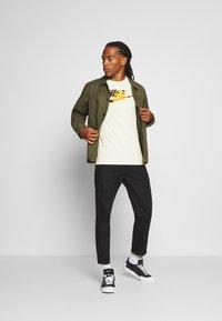 Nike Sportswear - TREND SPIKE - Print T-shirt - beige - 1