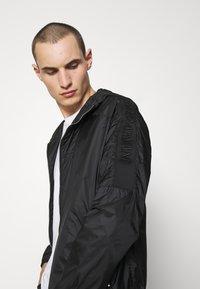 Emporio Armani - BLOUSON JACKET - Summer jacket - black - 4