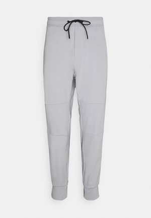 JOGGER  INVISIBLE ZIPPERS - Tracksuit bottoms - gray