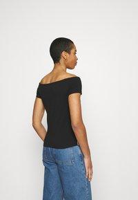 Calvin Klein - PIPING LOGO BARDOT - Print T-shirt - black - 2