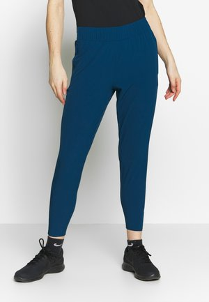W NK ESSNTL PANT - Trousers - valerian blue/reflective silver
