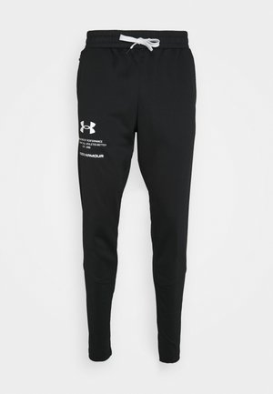 STORM PANTS - Jogginghose - black