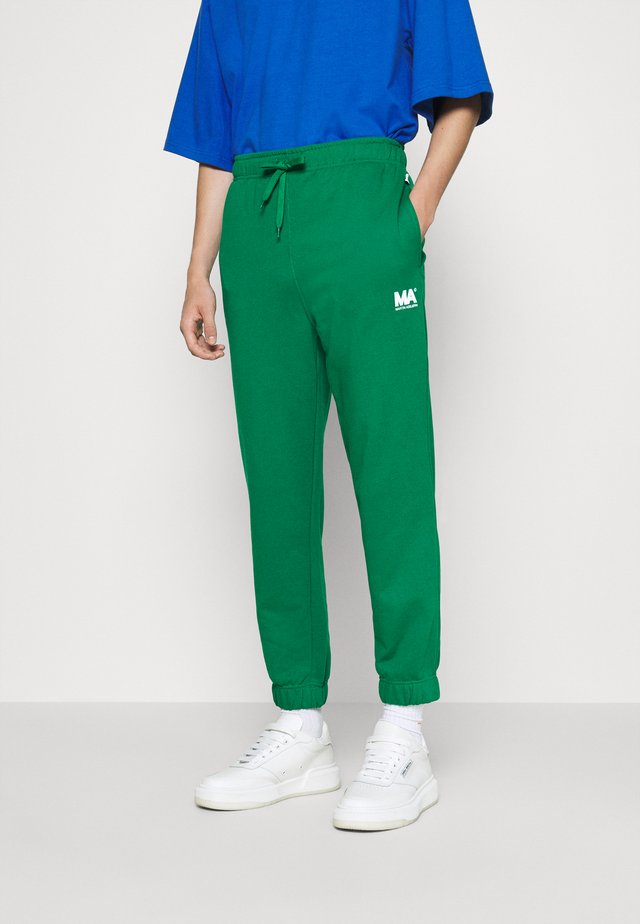 TRACKPANTS FLAME SCARLET - Tracksuit bottoms - evergreen
