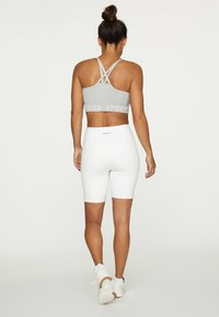 OYSHO - Medium support sports bra - grey - 1