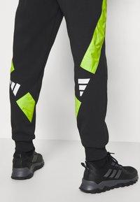 adidas Performance - URBAN PANT - Tracksuit bottoms - black/neon green - 4