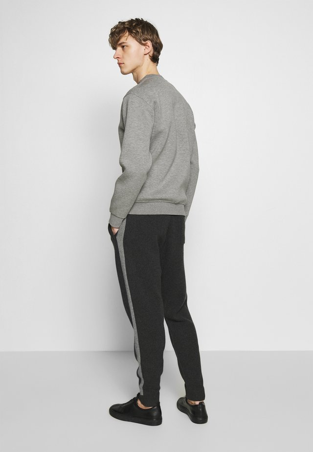 CRIMDEN  ASTINE  - Tracksuit bottoms - charcoal/grey