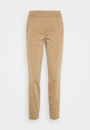 Trousers - mellow almond