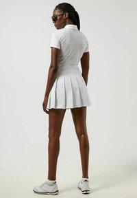 J.LINDEBERG - Sports skirt - micro chip croco - 2