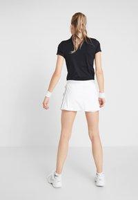 Nike Performance - DRY SKIRT - Sports skirt - white/black - 2
