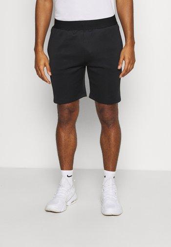 KEAN - Sports shorts - black