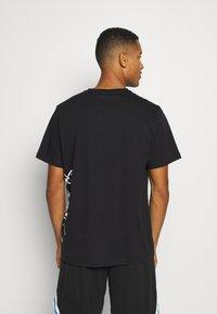 Puma - CAT JAWS TEE - Print T-shirt - puma black - 2