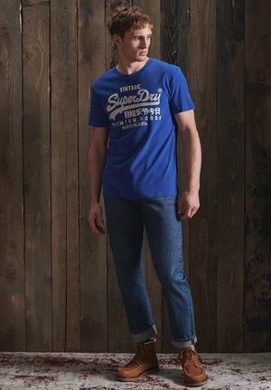 PISTE  - Print T-shirt - mazarine blue