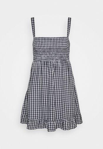 SMOCKED BABYDOLL SHORT DRESS - Day dress - navy gingham