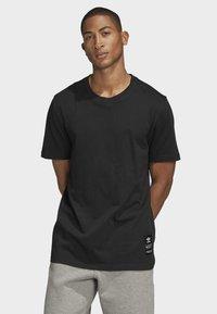adidas Originals - TREFOIL EVOLUTION T-SHIRT - Print T-shirt - black - 0
