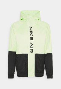AIR  - Waterproof jacket - black/light liquid lime
