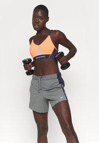 Nike Performance - INDY PRO BRA - Light support sports bra - bright mango/white/midnight navy/metallic silver - 4