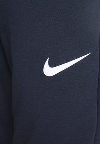 Nike Performance - PANT TAPER - Pantalon de survêtement - obsidian/white - 4