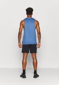 Nike Performance - FLEX - Sports shorts - black/iron grey - 2