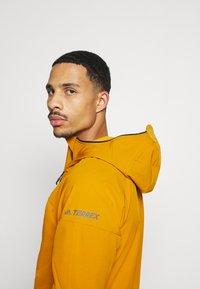 adidas Performance - Soft shell jacket - gold - 3