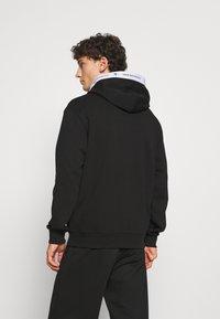Calvin Klein Jeans - TAPE HOODIE - Sweatshirt - black - 2