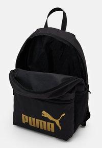 Puma - PHASE BACKPACK - Rucksack - black/golden - 2