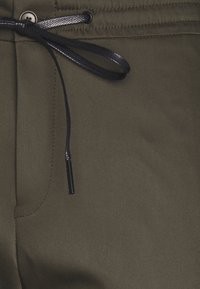 DRYKORN - JEGER - Trousers - mottled olive - 7