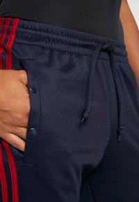 adidas Performance - SNAP - Tracksuit bottoms - dark blue - 4