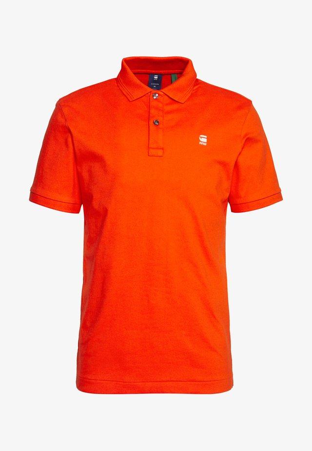 DUNDA  - Polo shirt - bright acid