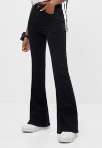 Bershka - Bootcut jeans - black - 0